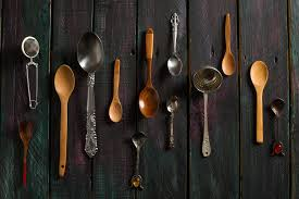 diffe types of spoon laid on a rustic table