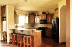 image of decorate above kitchen cabinets