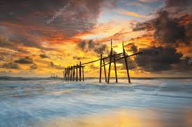 Wooden Bridge Game Sunset landscape with old wooden bridge at the beach game Stock 97