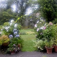 a seven foot tall steel moon gate arch arbor is 375 from hayneedle