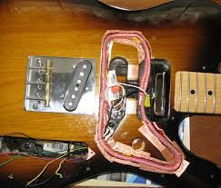 noise reduction for sc pickups telecaster and stratocaster the pus and coils are put in place for final tuning of the coil taps for the final coil shape wires from the coils and the pus are visible extending into