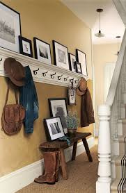 ideas wall shelf hooks: idea for the coat wall made from pine planks painted an aged whoitea shallow ledge at the top for some old rose paintingsthe extra dining chair in