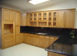 solid oak wood kitchen cabinet with black countertops