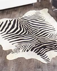 black on white zebra hide rug for cool floor decoration ideas