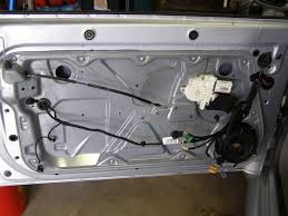 how to door panel window regulator and door latch removal unclip the electrical connector inside the door on the door latch assembly and verify no other wires or clips are in place then remove the whole inner panel