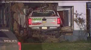 U-Haul pickup truck plows into home, father injured | khou.com