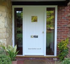 white cottage door with sidelights