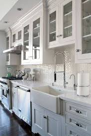 Love the mini subway tile backsplash. Grey/white kitchen w/ dark wood  floors.