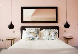a horizontal mirror expands the sense of space in a bedroom mirrors can be heavy and dangerous if they fall use caution when hanging one or hire a