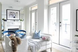 white tete a tete sofa with blue velvet chairs