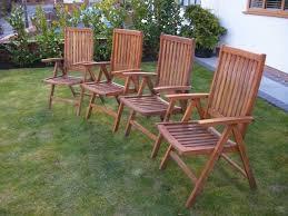 4 matching teak recliner garden chairs