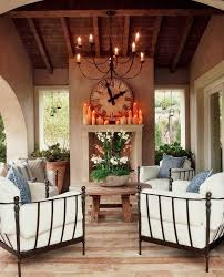 lighting extraordinary patio chandelier outdoor 23 candle shabby chic with arched doorway brick floor covered fireplace