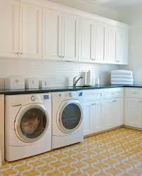 white laundry room cabinets with honed absolute black granite countertops