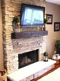 reclaimed wood mantel brick fireplace