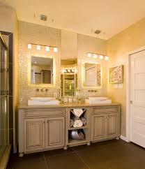 double vanity with white porcelain rectangle vessel washbasin also four light bathroom sconces over mirror vanity