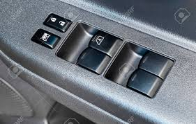 car door lock button. Stock Photo - Switch On Armrest In Car Door Interior For Window Control  Panel And Lock Button. Car Button