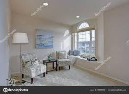 light filled master bedroom with reading nook stock photo