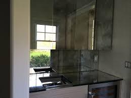 Mirrored Backsplash In Kitchen L Shape Kitchen Design And Decoration Using Light Glass Mirrored