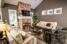 living room brick fireplace with wood wrapped mantle craftsman living room