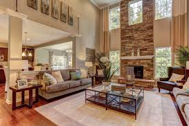 Great Room Windows Flank A Soaring Stone Fireplace In This Two Story Great