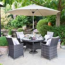 nova sienna 4 seat outdoor rattan dining set 1 05m round garden table chairs brown