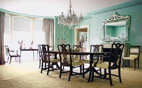 this gorgeous dining room is made complete by the crystal chandelier over the table
