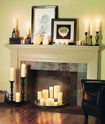 candles add beautiful light to an off season fireplace