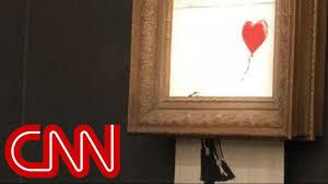 Watch Banksy's $1.4 million painting 'self-destruct' - YouTube