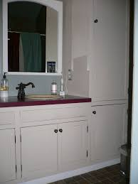 elegant black wooden bathroom cabinet. bathroom furniture vanity linen cabinet and white wooden closet with sink plus black faucet also corner elegant l