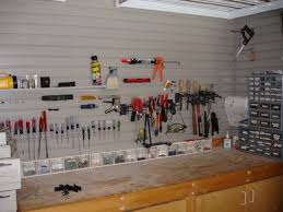 garage decor ideas with wall storage and wood floor for inspiration ideas