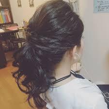 Tomimatsu Kaoriさんのヘアスタイル 低めのポニーテール黒髪