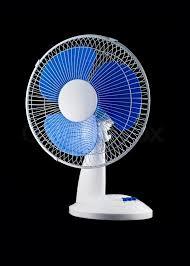 modern desk cooling fan over black background stock photo