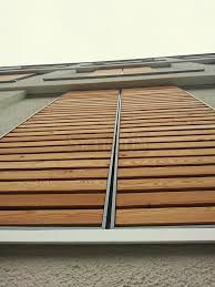 private house in nufringen germany skirpus outdoor wooden sliding shutters thermo wood louvers