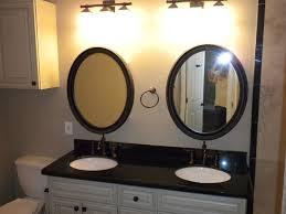 Bronze Mirror Bathroom White Cabinets With Chocolate Glaze Black Granite Oil Rubbed