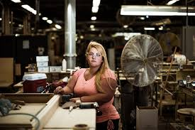 sasha peyton stands in the sanding department at century furniture in hickory nc century furniture cheap asian furniture