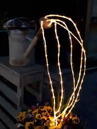 Gieter Met Lampjes Overkapping En Tuin Gieters Tuin En Etalage