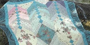 Showcase Beautiful Fabrics in This French Braid Quilt - Quilting ... & Jelly Roll French Braid Quilt Adamdwight.com