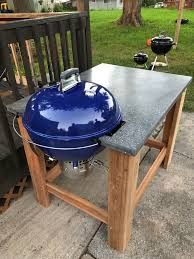 something i constructed cedar table with concrete top weber kettle nearly complete