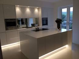 modern kitchen lighting design. kitchen design and inspiration modern white gloss integrated handle with corian wrap worktops by hollyanna lighting l