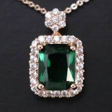 green emerald round diamond halo