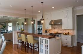 traditional kitchen example of a classic open concept kitchen design in raleigh with shaker cabinets wood kitchen pendant lights ceiling lantern pendant lighting