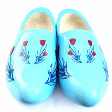 dutch wooden shoes clogs with red tulips