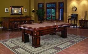 legacy pool table on area rug and hardwood floor