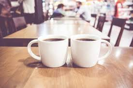 two coffee cups with coffee. Modren Coffee Vintage Filter Couple Of White Coffee Cup On Wood Table With Blurred Cafe  Bokeh Light To Two Coffee Cups With E