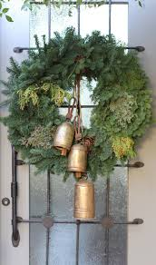 3 the wreath with the vintage bells and that gorgeous door ...