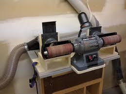 hand held drum sander. sanding station connected to dust collection system hand held drum sander