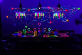 glow in the dark dining table from a glow birthday party on kara s party ideas