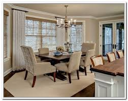 short window curtain rods in dark finishing white floor to ceiling window curtains a set of dining furniture white dining carpet pendant chandelier fixture