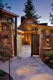 rustic courtyard ideas entry rustic with stone wall garden lighting outdoor lighting