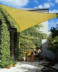 the 16 foot coolaroo shade sail is made from a commercial grade fabric that